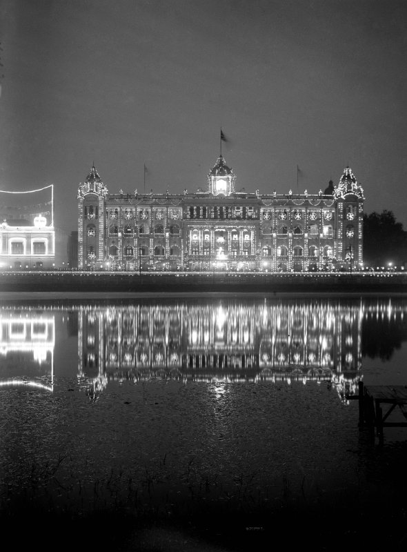 The 'new' Bengal Club, Kolkata lit for British royal visit; seen from across the General's Tank on the Maidan.  This part of the club is now demolished, having been completed in 1908 by the architect J Vincent Esch (who was also supervising architect for the Victoria Memorial, Kolkata).