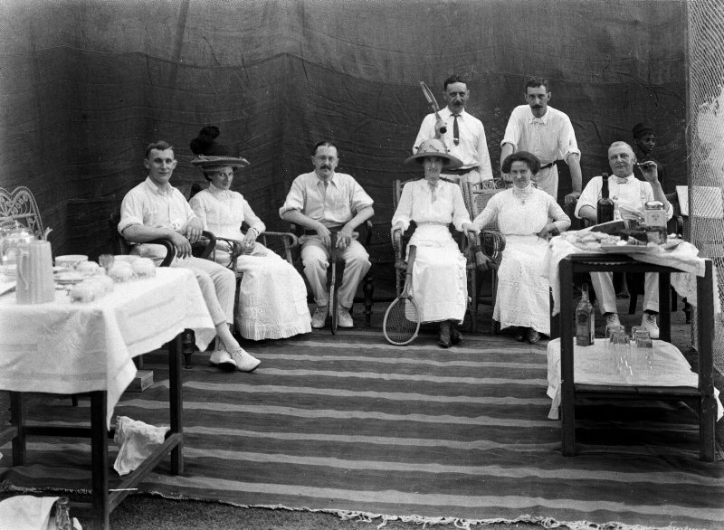 Seated group with tennis raquets.  Unknown location, probably Kolkata.