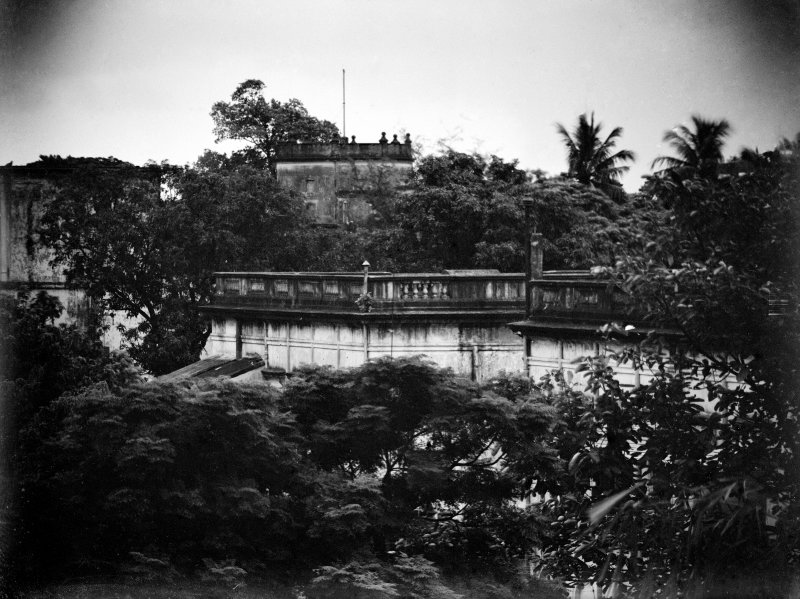 Building viewed through trees.  Unknown location.  [Possibly Fort Wiliam or the Presidency Jail, Kolkata.]