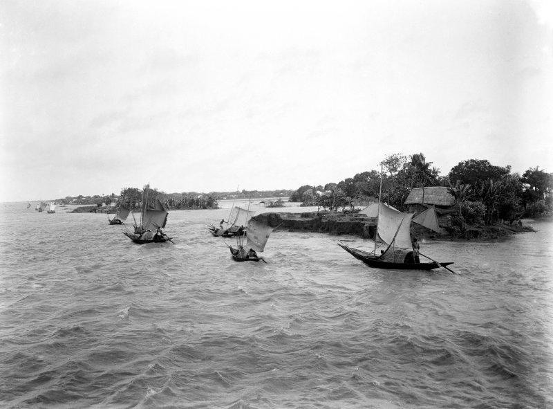 Possible large lake or coastal scene with fishing boats.  Unknown location.