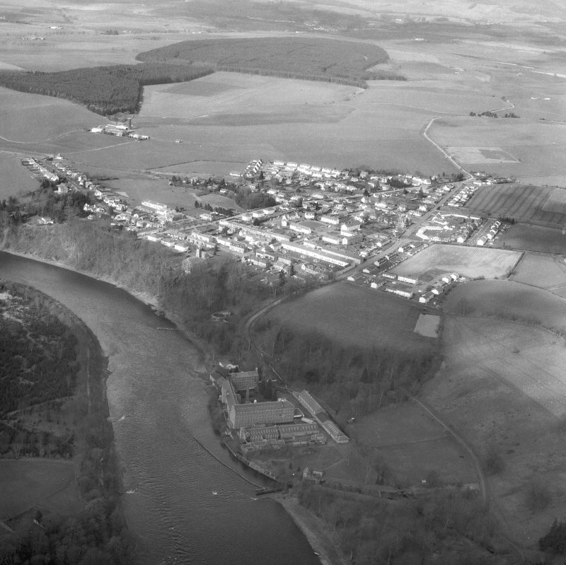 Oblique aerial view centred on Stanley Mills and village .