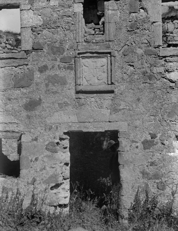 View of doorway with sculpted stone above, East range