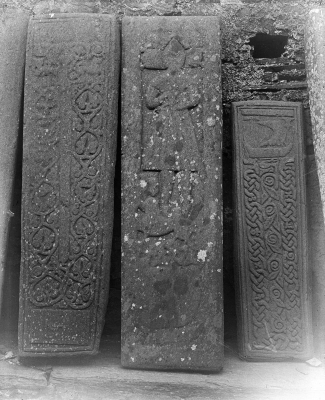 Oronsay Priory, grave-slabs. General view of three grave-slabs.