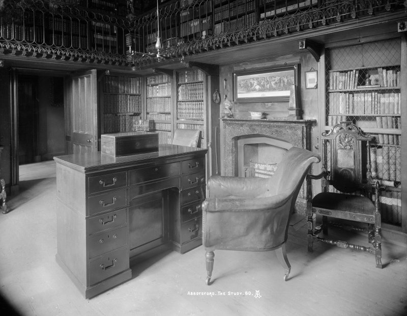 Interior-general view of Study with desk and chair in front of fireplace and books, also showing part of balcony