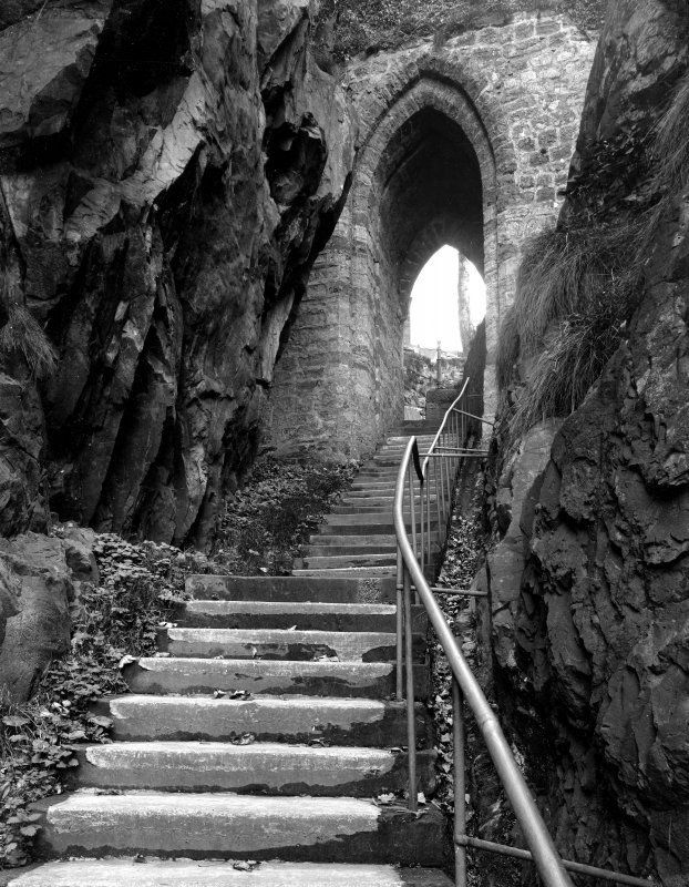 Exterior view of portcullis arch and stairs at Dumbarton Castle.