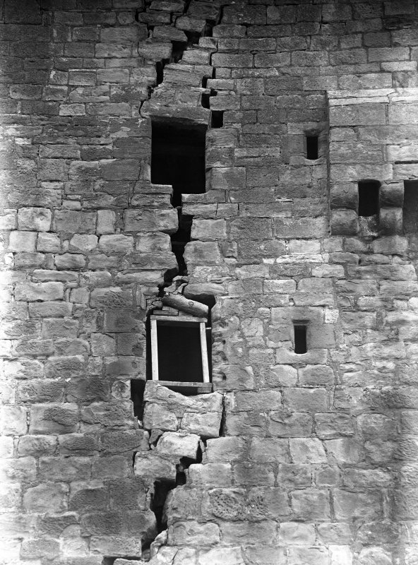 View of damaged wall in old tower.