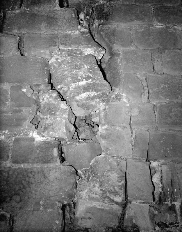 Detail of cracks in stonework.