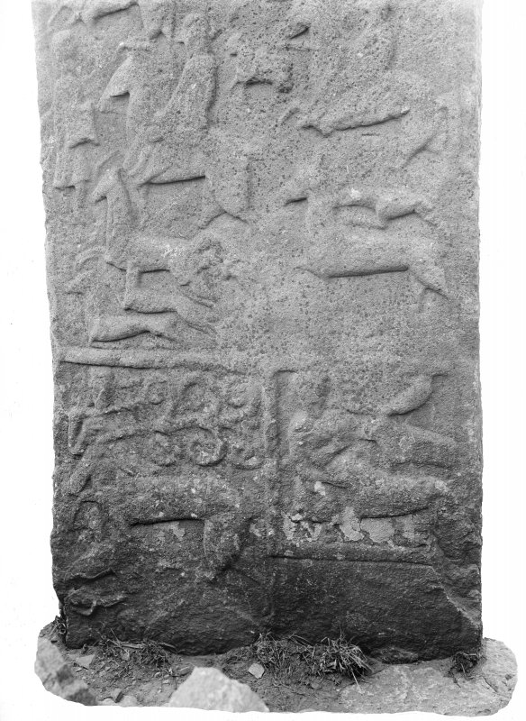 Detail of lower portion of reverse of Aberlemno no 3, the Roadside cross-slab, showing hunting scene, plant-bearing centaur, and David wrestling with the Lion.
