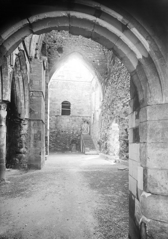 View through tower into S transept with staircase.