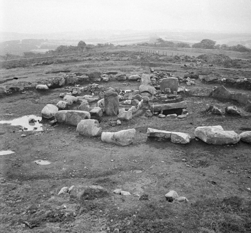 Inner kerb stones of period III cairn at excavation of Cairnpapple henge and cairn, by Professor S Piggott.