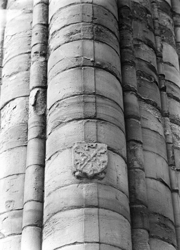 Jedburgh Abbey Detail of carved stonework: shield with three cranes, two pastoral staves and initials of Abbot Cranston, on SW pier crossing.