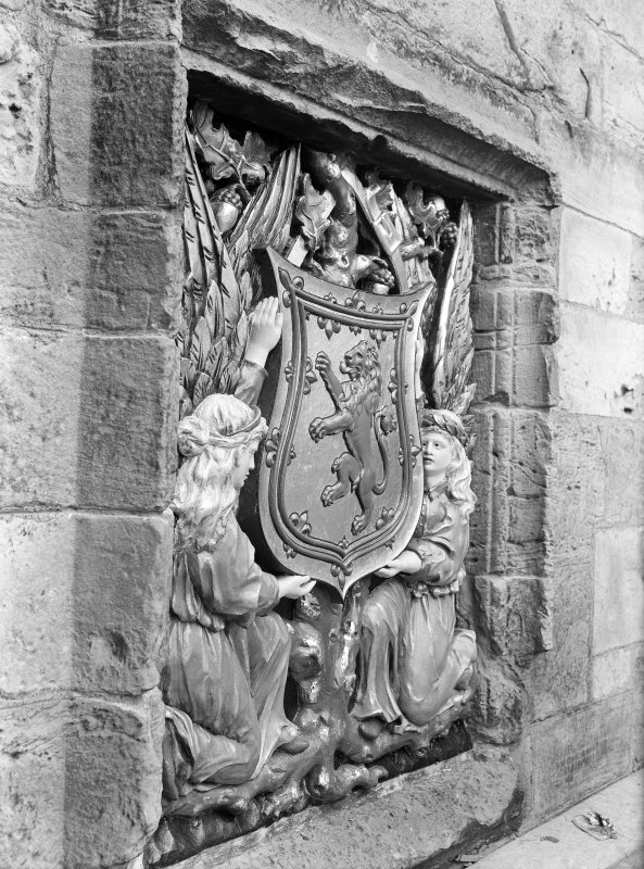 Detail of heraldic plaque belonging to  3rd Marquess of Bute on South turret of gatehouse.