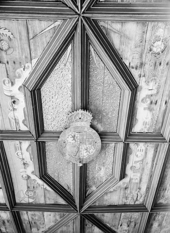Interior. South range. Second floor. Detail of central panel and coat of arms in chapel ceiling.