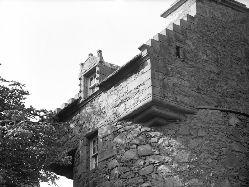 Dundee, Claypotts Road, Claypotts Castle. View of South-East tower with three tier corbels and dormer window.