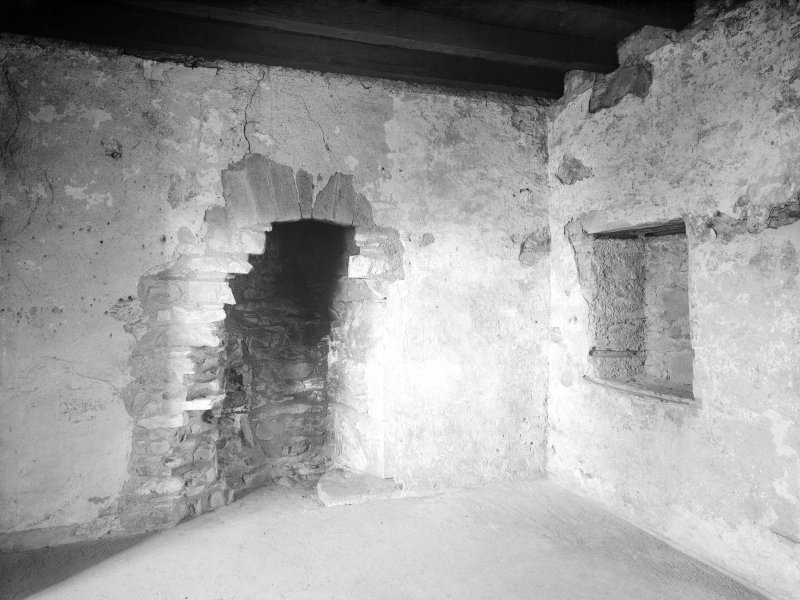 Dundee, Claypotts Road, Claypotts Castle, interior. General view of fireplace and wooden beams of roof.