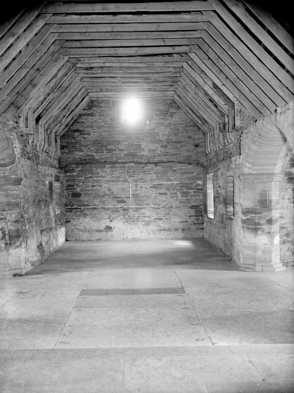 Interior. General view to West down Nave showing wooden rafters.