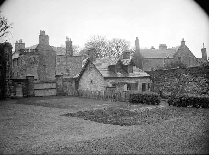 Cottage & entrance (now removed) on west side of encroaching wall.