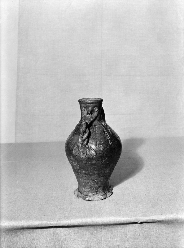 A pottery jug: frontal.