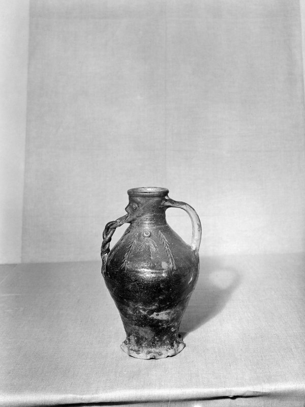 A pottery jug: from the side.