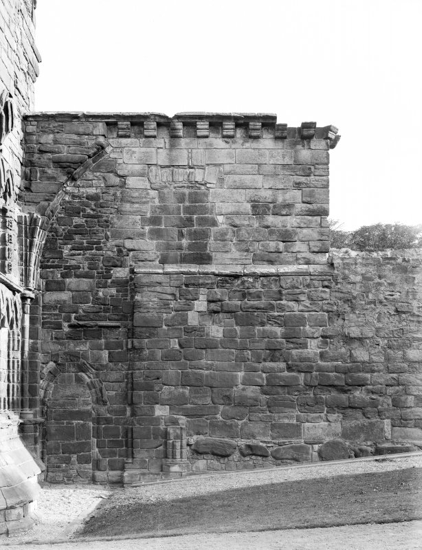 West front, south wall showing cut off arcade.