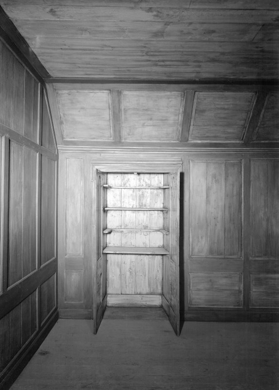 Panelled room with cupboard. South wing