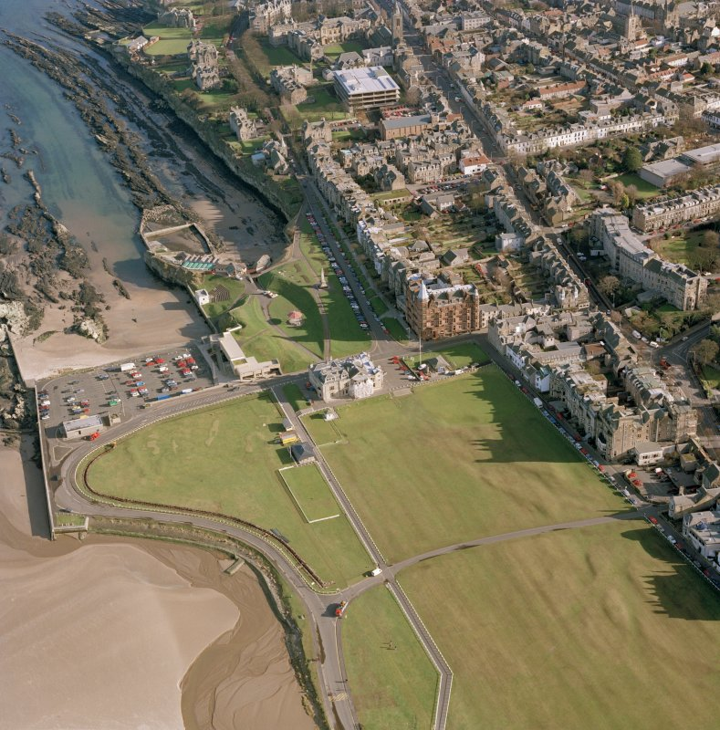 Oblique aerial view centred on the Royal and Ancient Golf Club, St Andrews.