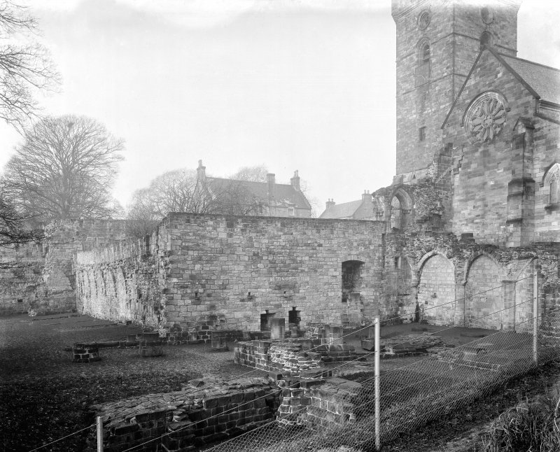Remains of Chapter House and cloister garth looking north west