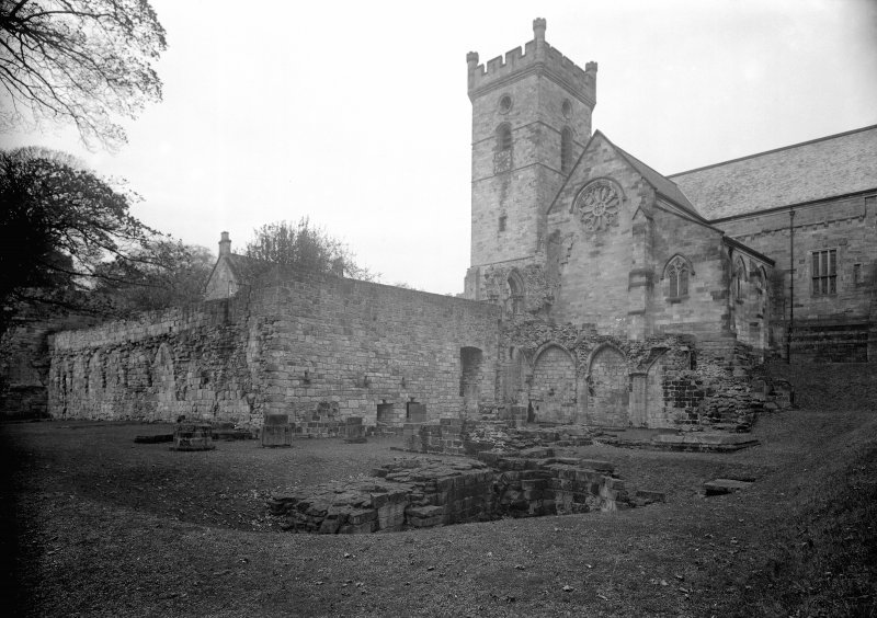 Remains of sacristy, chapter house and cloister garth wall looking north west