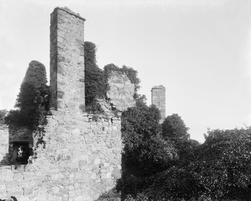 View of castle gable ruins covered in ivy.