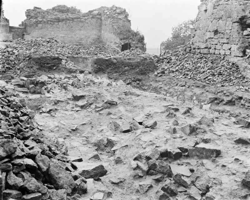 Detail of collapsed walls and rubble.