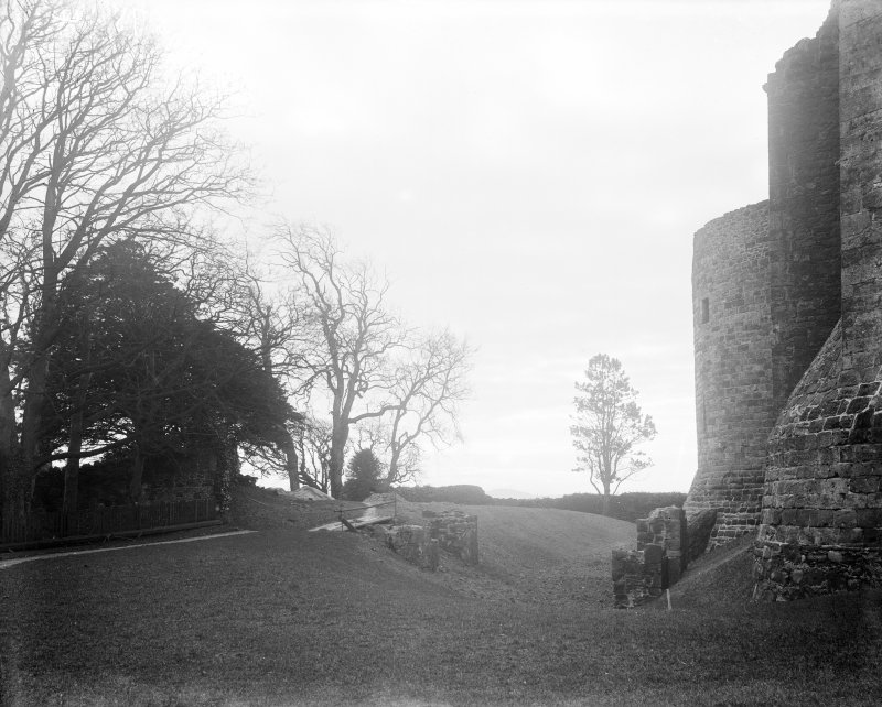 View of moat and remains of piers.
