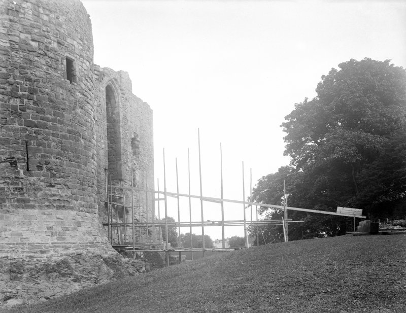 View of construction of wooden bridge across moat.