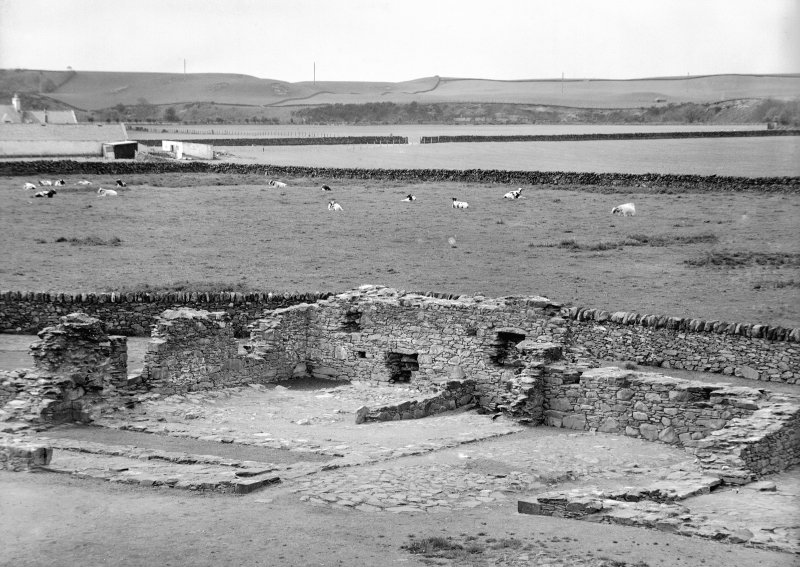 View of ruins of domestic buildings.