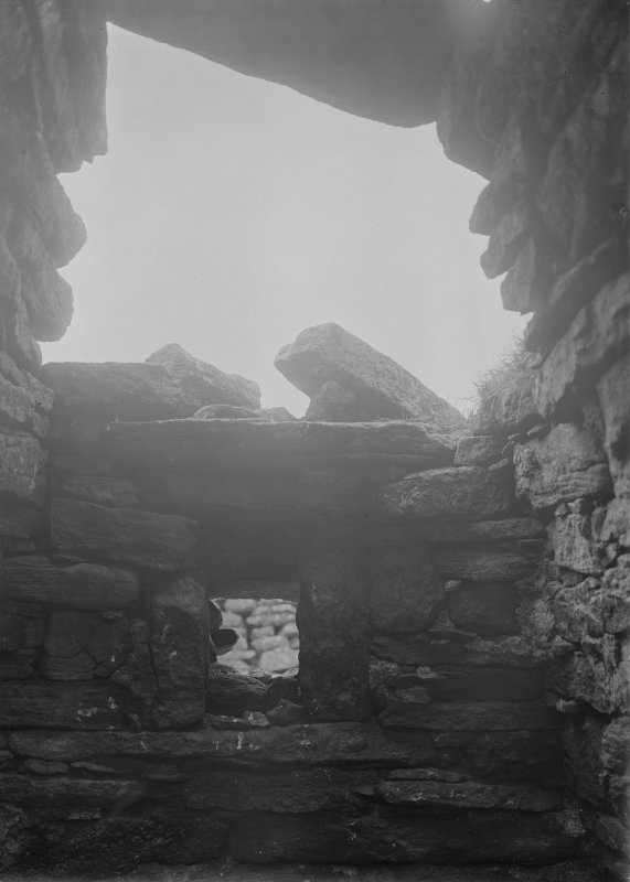 Oratory cell, detail of roofing and light at SW of cell.