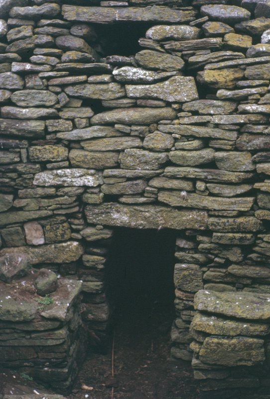 Detail of stonework and entrance to cell, taken from the SW.