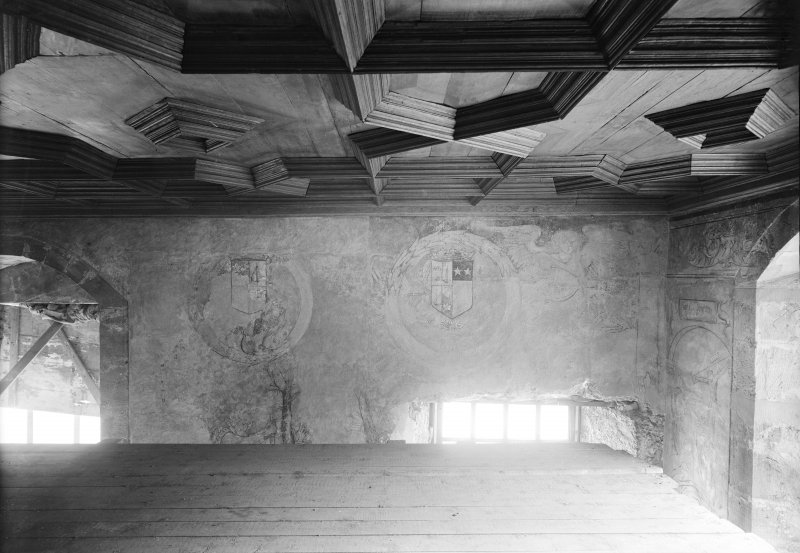 Interior. Detail of panelled ceiling and painted wall.