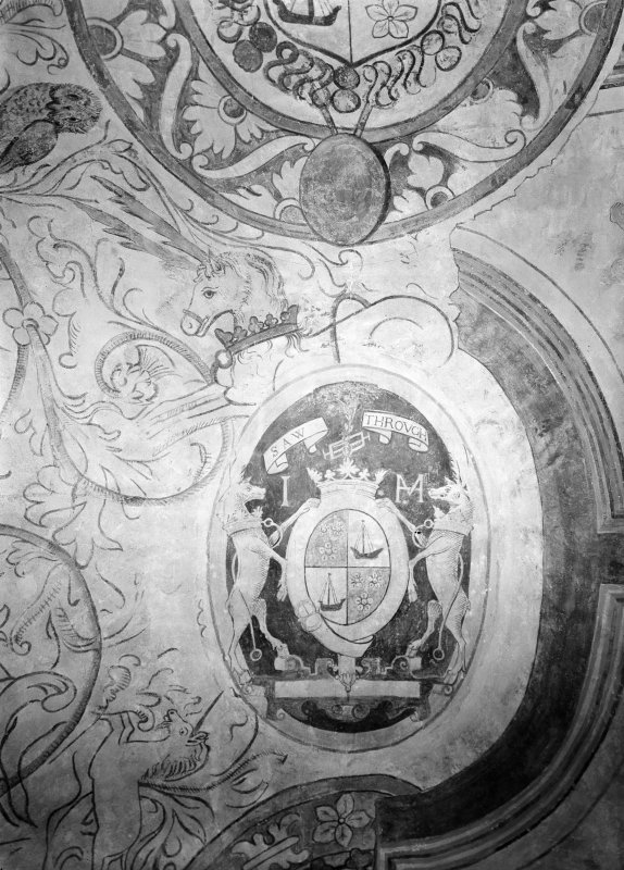 Interior. Detail of coat of arms on ceiling of N room.