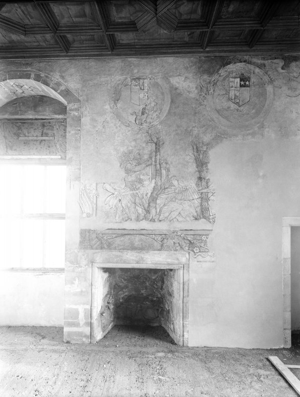Interior. View of painted E wall of S room including fireplace.