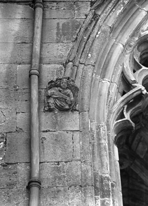 Interior. Detail of carved angel in S transept.