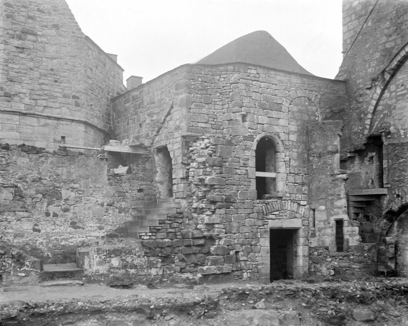 North East corner of court, showing stairway, original position of arches & roof