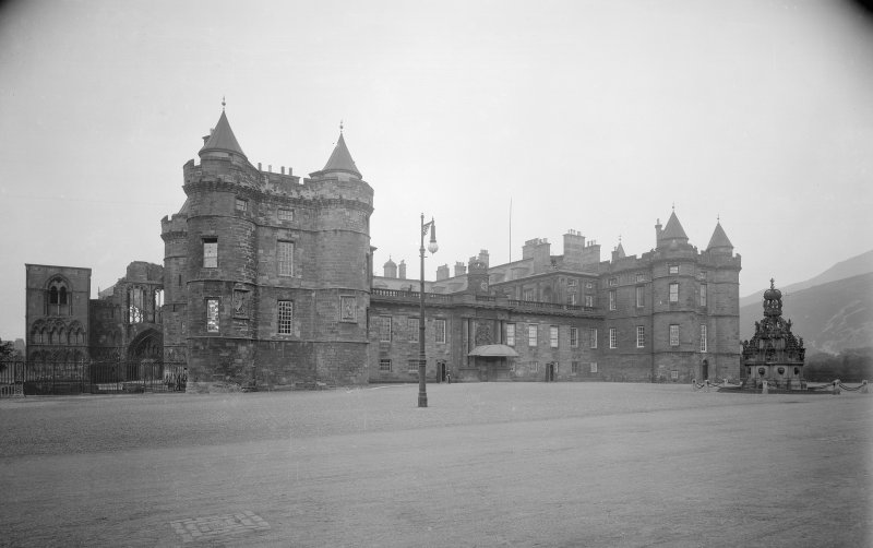 General view of main entrance front of Holyrood Palace showing James IV's Tower, part of Holyrood Abbey and Fountain in forecourt