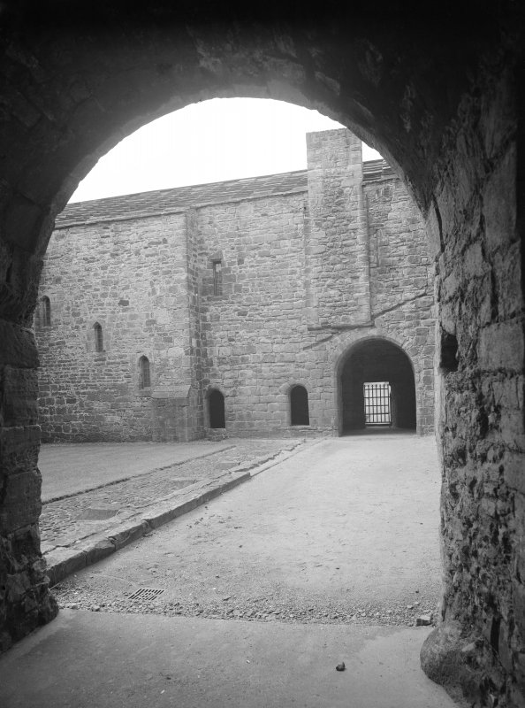 Looking through East entrance in cloister to West wall