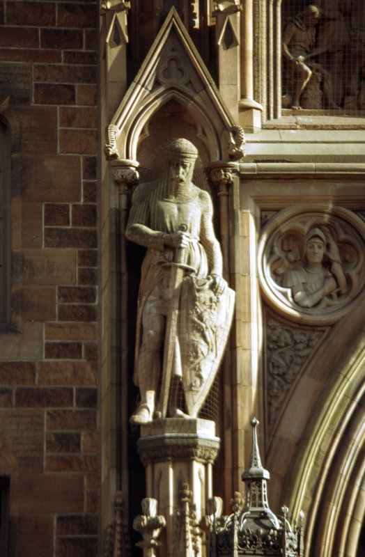View of statue of Sir William Wallace, in left lower niche of main entrance, N facade.