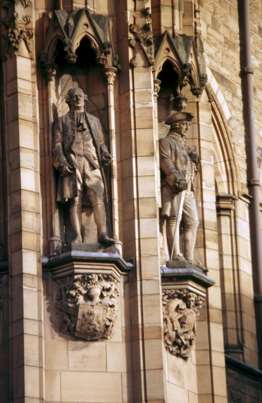 View of statues of David Hume, third from left, and Adam Smith, fourth from left, NW tower.