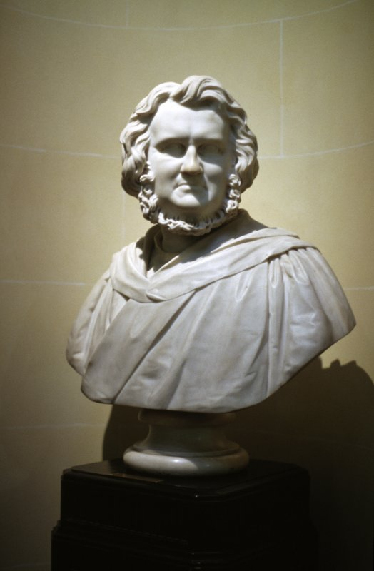 View of marble bust of Sir James Young Simpson, Bart, M. D. by William Brodie, 1871, at the top of the stairs, E side.