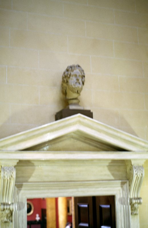 View of head of Aesculapius, above door to the Hall.