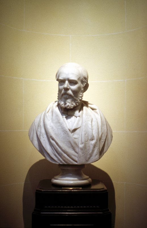 View of marble bust of Daniel Rutherford Haldane M. D. by Charles McBride, 1888, at the top of the stairs outside the library, E side.