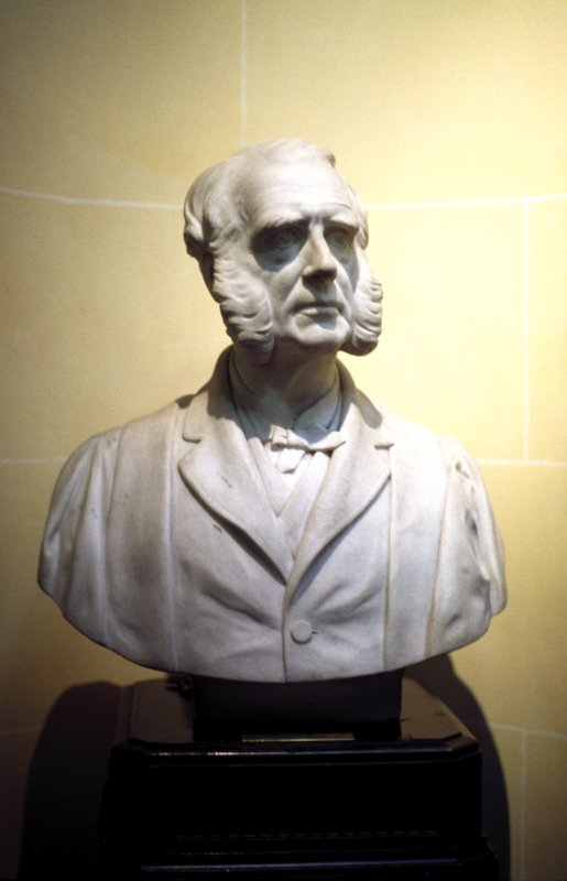 View of marble bust of Sir Andrew Douglas Maclagan M. D. by John Hutchison, at the top of the stairs outside the library, W side.