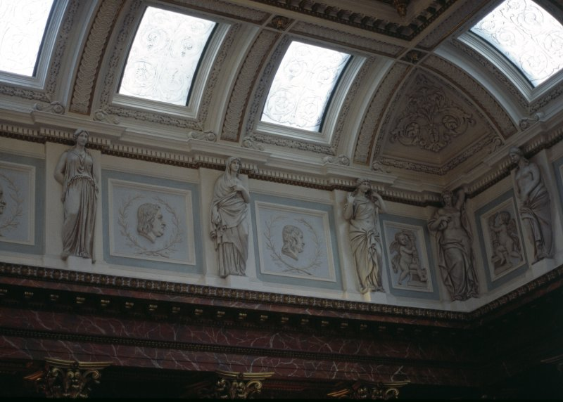 View of the frieze in the Hall, showing portrait profiles of William Smellie, Herman Boerhaave and Thomas Sydenham, with representations of Hygeia, and two panels carved with a cherub.