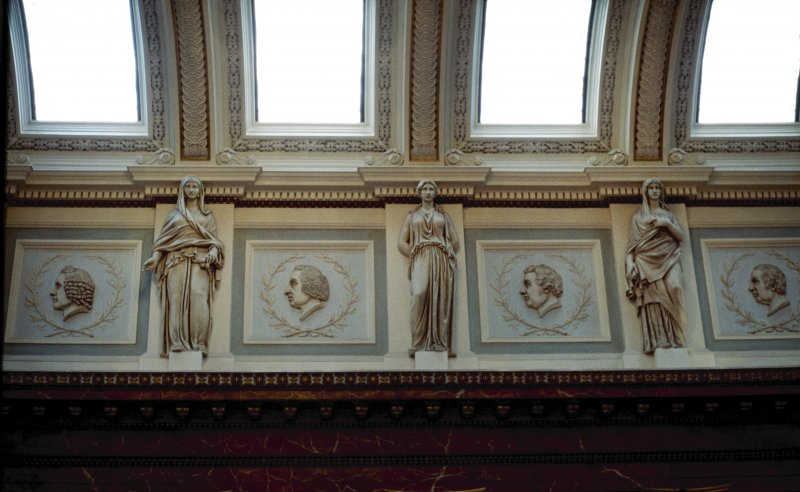 View of the frieze in the Hall, showing portrait profiles of Alexander Monro primus, William Cullen, Edward Jenner and Mathew Baillie, with representations of Hygeia.